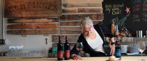 winemaker with wine behind bar